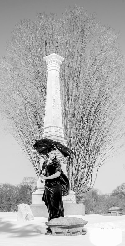 Model Capri Lanning photographed by Fine Art Photographer David Lee Black in Swan Point Cemetery.