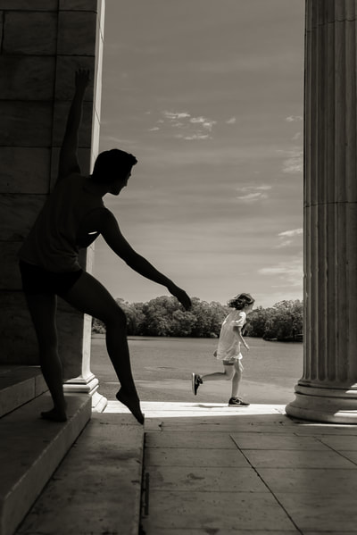 Fine art photographer David Lee Black photographs child running and male ballet dancer at Temple to Music for long distance runner exhibition.