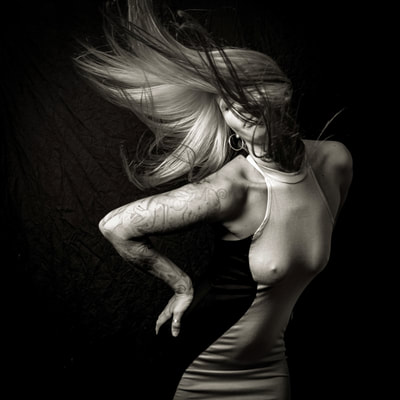 Fine art photographer David Lee Black Black black and white with tattoo, female model, blowing hair.