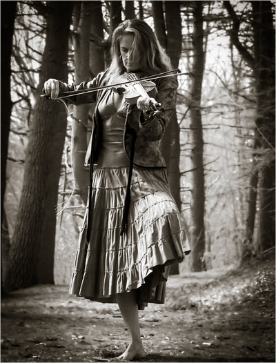 Fine art photographer David Lee Black Black with model, violin, fiddle in the pine trees.