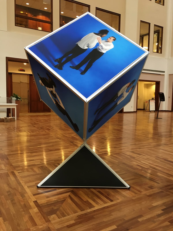 Noted fine art photographer and sculpture artist David Lee Black collaborates with Vermont fine art painter Matthew J. Peake with the Outside the Box Project involving an 8 ' tall cube showing six sides of the human forms.