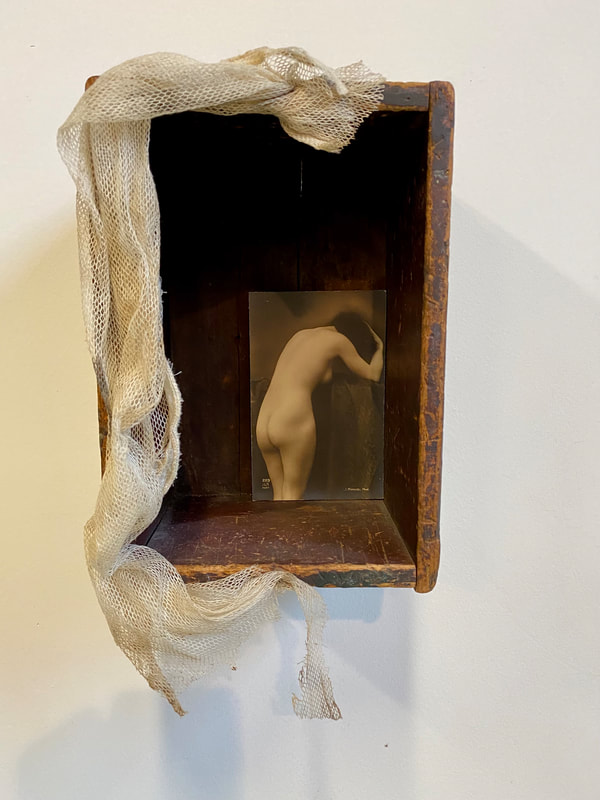 Noted Boston sculpture artist David Lee Black creates assemblage with vintage French porn postcards collectible with vintage wooden box and antique Belgium Lace.