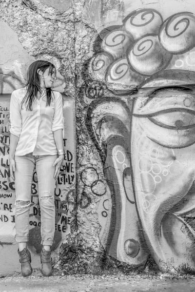 Singer songwriter Allison Rose photographed by David Lee Black with graffiti at Fort Wetherill, Rhode Island.