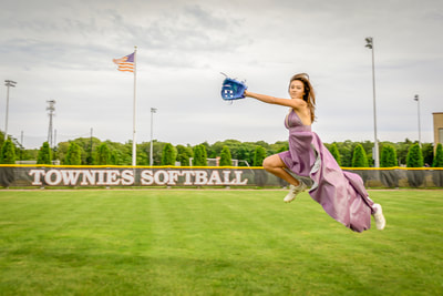 Fine art photographer David Lee Black with model with purple dress playing softball catching ball with american flag.