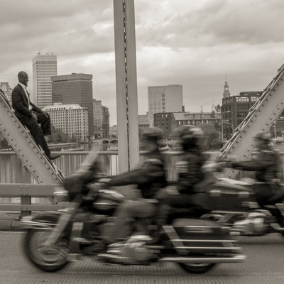 Sidy Maiga photographed by fine art photographer David Lee Black at Wichendon Bridge, Providence, Rhode Island with motorcycles.