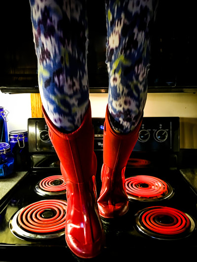 fine art photographer David Lee Black Wandress, cancer survivor walking on hot stove with Bog boots and psychedelic yoga pants.