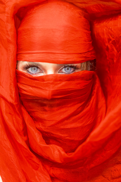 Fine Art photographer David Lee Black portrait of artist, hooper, belly dancer Jessie Jewels with blue eyes, red scarf, Beautiful female model