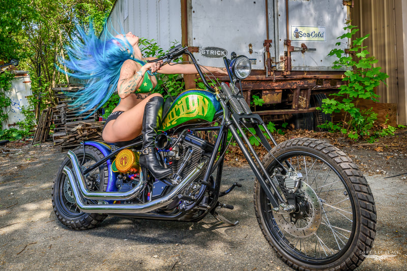 Blue-haired bikini model on custom chopper motorcycle photographed by David Lee Black.