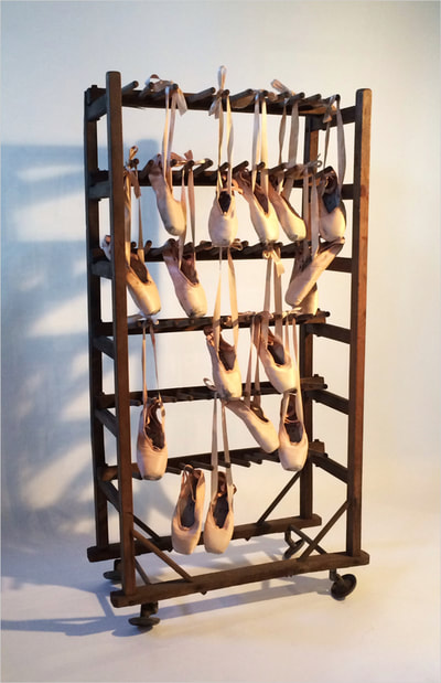 "Noted Boston sculpture artist David Lee Black creates assemblage with pointe shoes from Island Moving Company, Newport's contemporary ballet company with a pre-civil war shoe drying rack ""Silently and Light of Foot."""