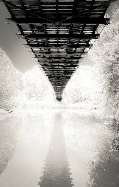 Fine art photographer David Lee Black with his black and white photograph of a Missouri pre-civil war bridge in infrared journey and destination.